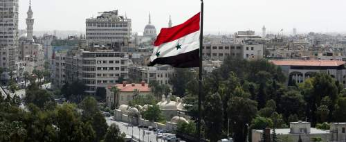 Un drapeau syrien flotte dans la capitale Damas, en avril 2018 (photo d'illustration).