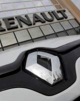 A Renault automobile is displayed outside a dealership in Marseille February 1, 2013.